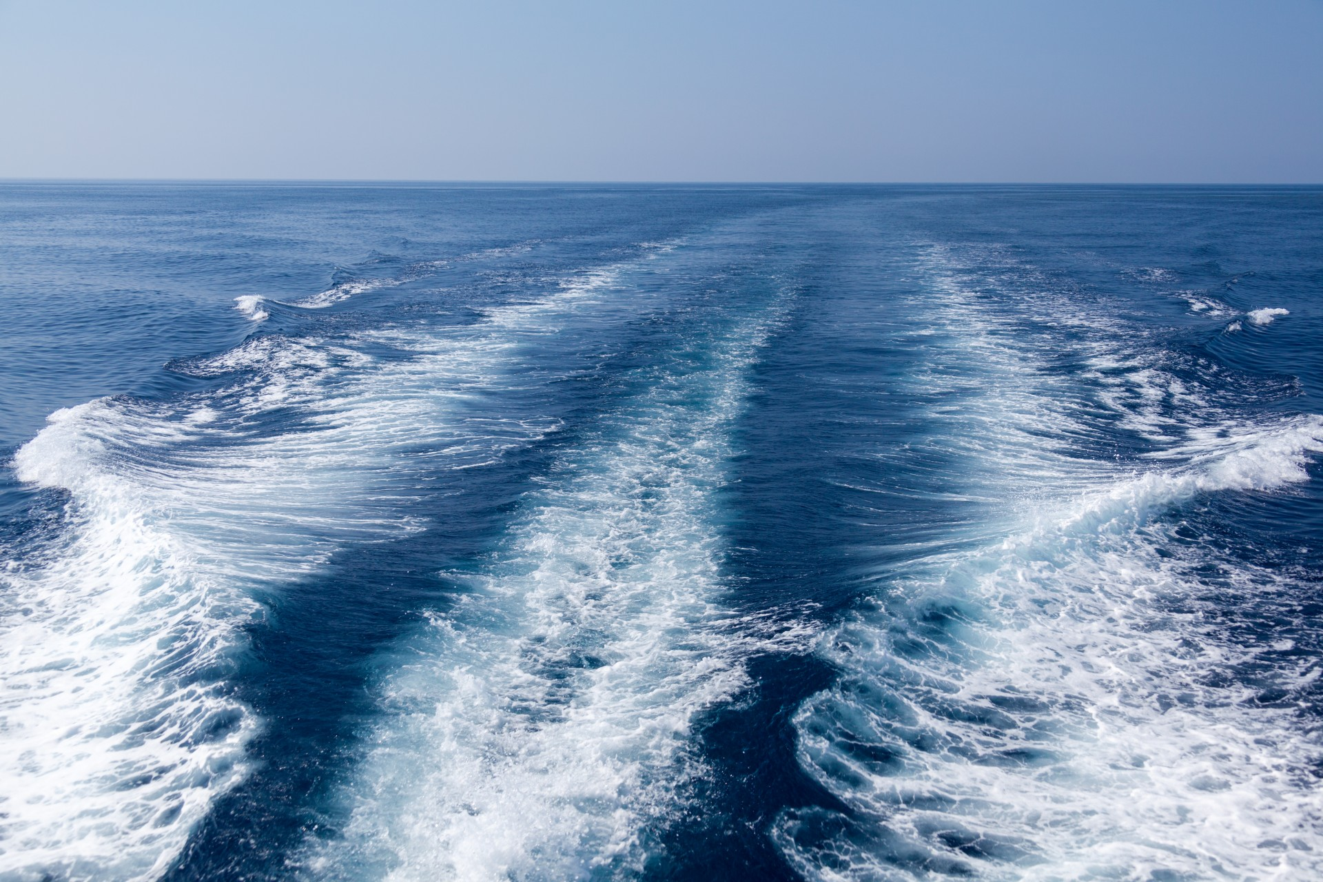 Photo of waves behind a boat (sillage) by Petr Kratochvil